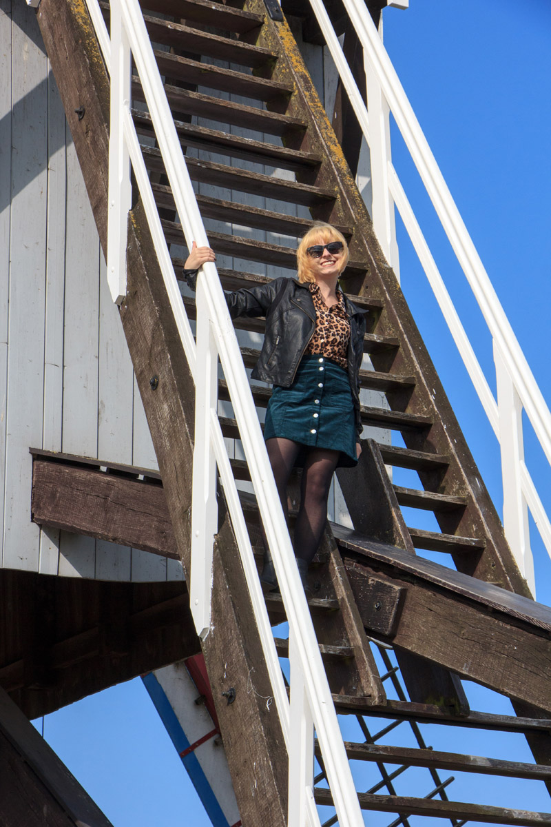 Windmill Stairs in Bruges Wearing a Leopard Silk Top Faux Leather Jacket and Green Corduroy Skirt