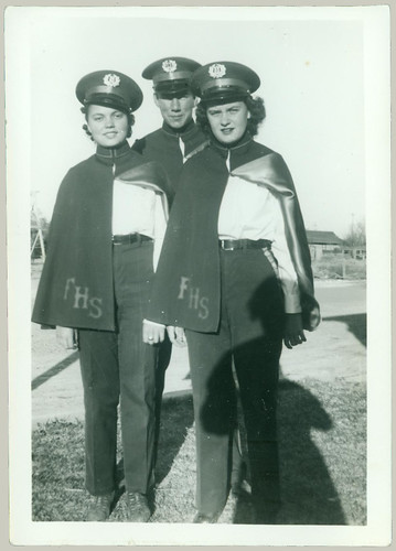 Three in Band Uniforms
