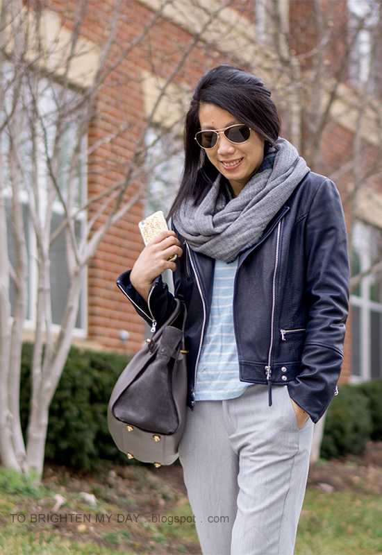 herringbone and plaid infinity scarf, black leather jacket, light blue striped top, gray pants
