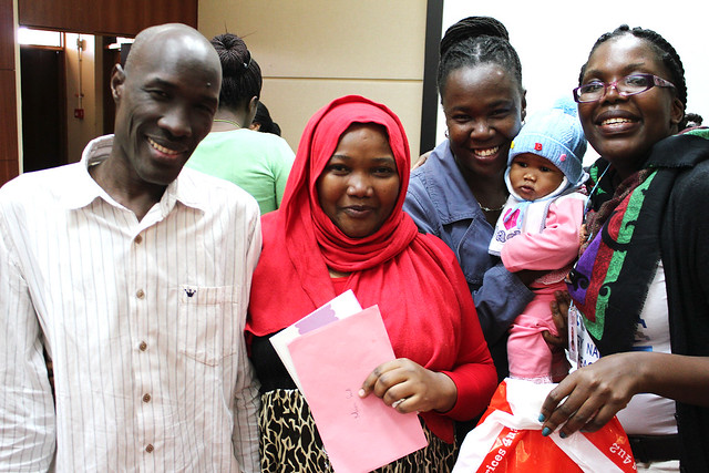 Africa Bioscience Challenge Fund Fellow Rasha Adam and her family pose with BecA-ILRI Hub communications officer Ethel Makila and capacity building officer Valerian Aloo, Nairobi, Kenya