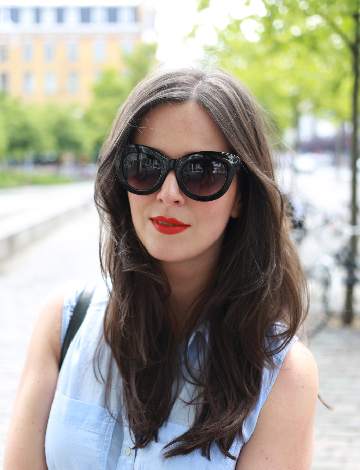 Cat eye sunglasses, orange-red lipstick
