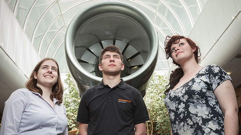 Students on placement at Renishaw look upwards under a turbine