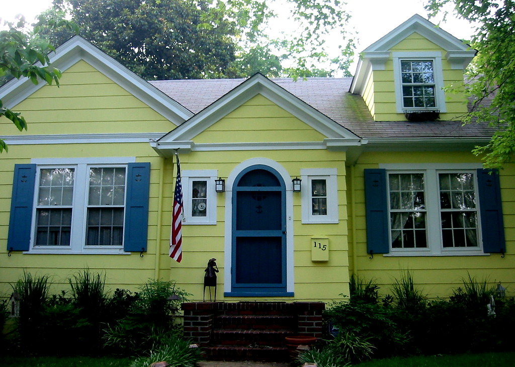 Yellow house blue shutters furnishing interior design for Modern yellow houses