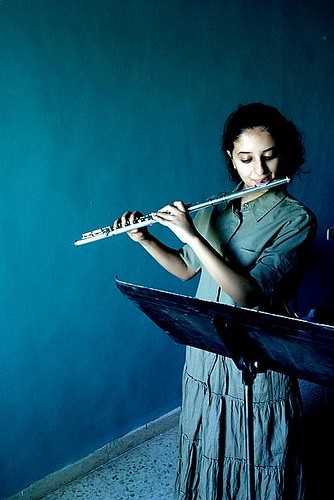 Girl playing the flute | by Sabri Hakim