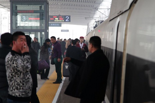 Smokers pile out of the train at Handan East for a quick smoke