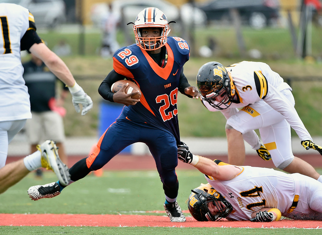 © 2016 by The York Daily Record/Sunday News. William Penn's Nigel Williams carries the ball past Red Lion's Patrick Daugherty in the first half of a YAIAA football game Saturday, Sept. 24, 2016, at Small Field in York.