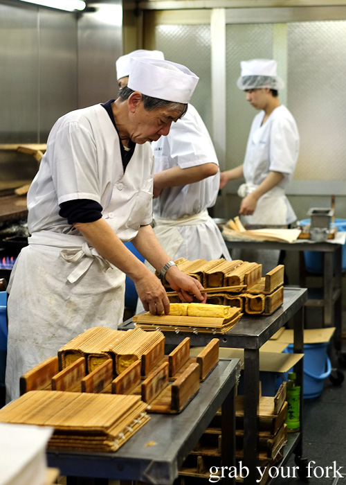 Compressing the rolls of tamago at Miki Keiran at Nishiki Market, Kyoto