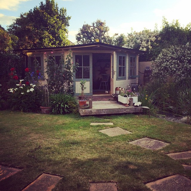 My parents' garden is so nice, I think I'm going to move into their summerhouse... {#garden #summerhouse #blueskies}
