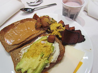 Breakfast Day 1 Part 1 - PB on toast, Heidi Ho chevre, avocado and nooch on toast, Sweet Earth bacon, roast fries, SD strawberry banana coconut yoghurt, Chao cheese
