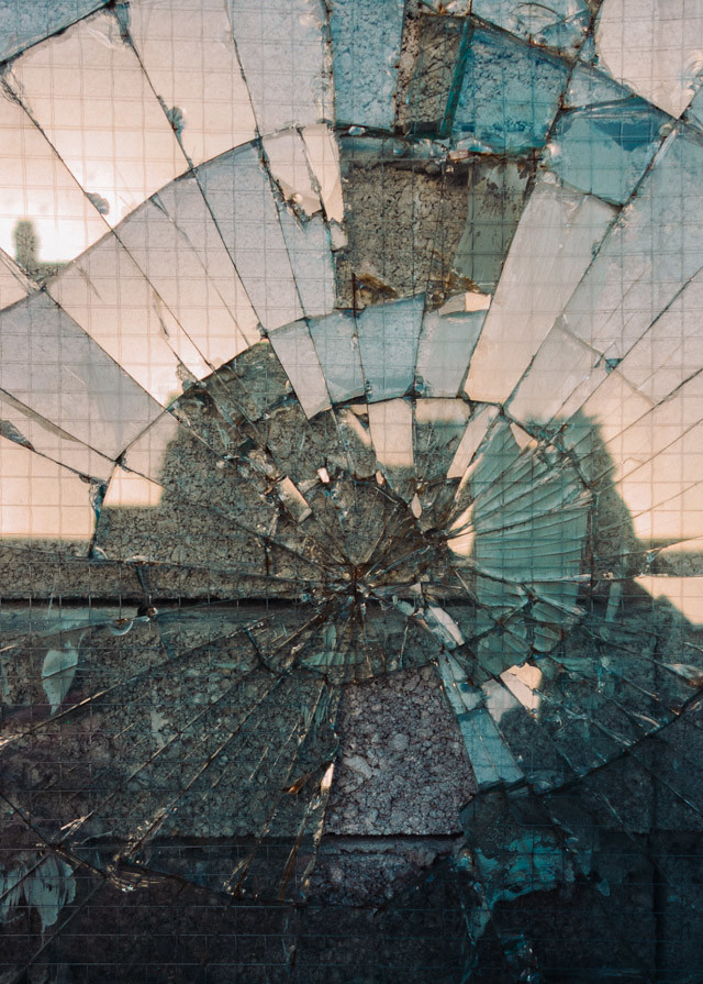shattered window and reflection