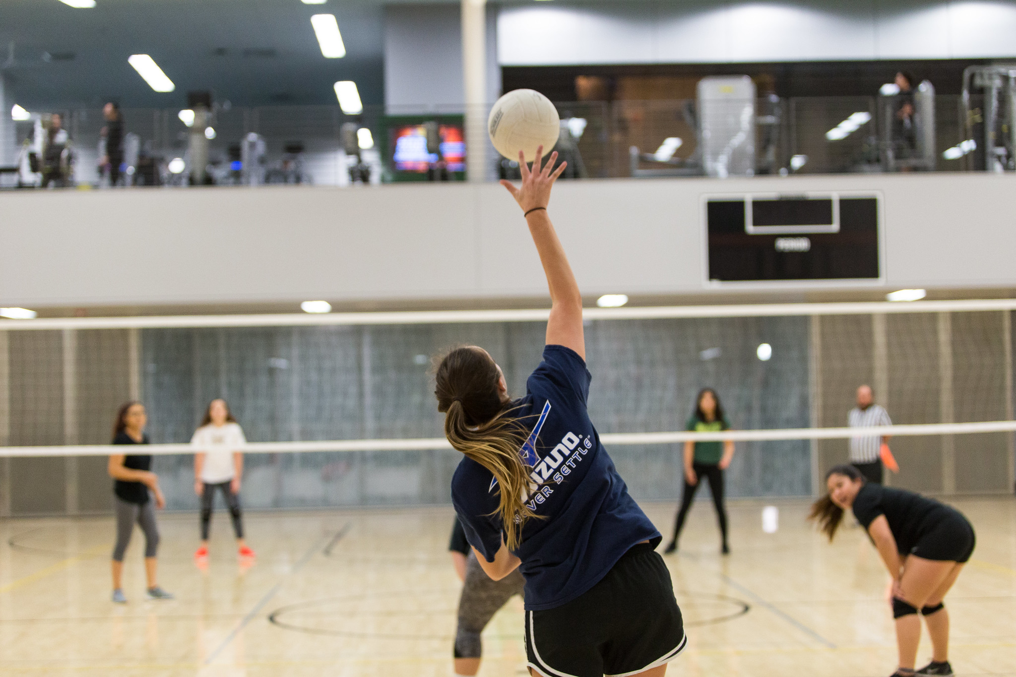 Student playing intramural volleyball
