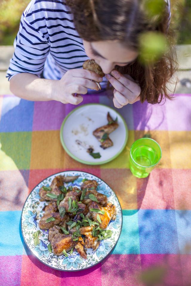Enjoying Pomegrante Molasses Chicken Wings, Borough Market Markt Life Issue 20