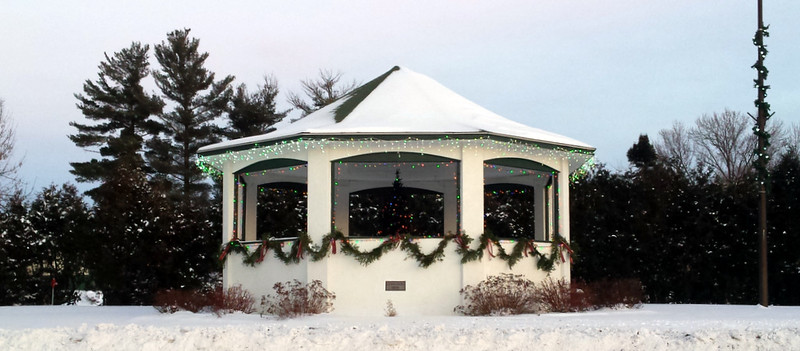 garland circling the gazebo under the windows, icicle lights circling the roofline