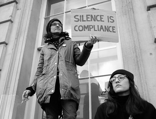 Silence is compliance - A protester with a message standing on a window ledge in Whitehall. | by alisdare1