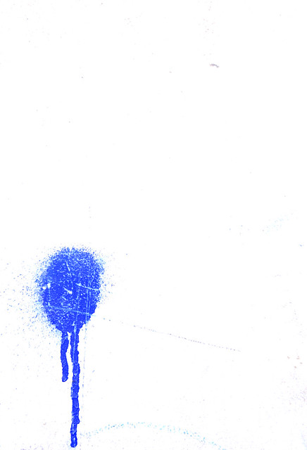 Dripping Blue Paint Over Black