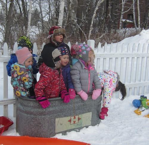 bunch of kids in a bucket