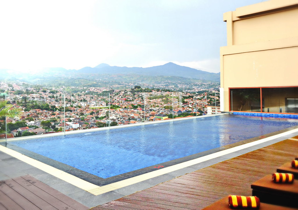 At The Rooftop Infinity Pool You Get An Amazing View Of City Surrounded By Mountains