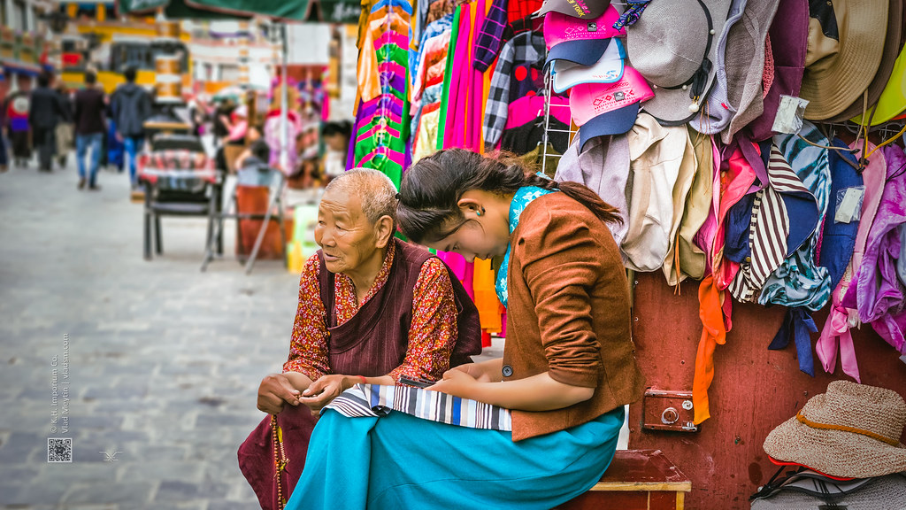 Tibet, candid shot of an old woman and a lady sitting at their street shop (Lhasa, China), 06-2016, 91 (Vlad Meytin, vladsm.com)