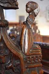 bench end: praying woman (15th Century)
