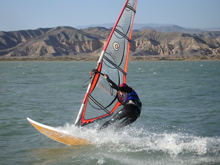 Manuel windsurfing at Playa Lamaral in Rodeo, Argentina | by focajonathan