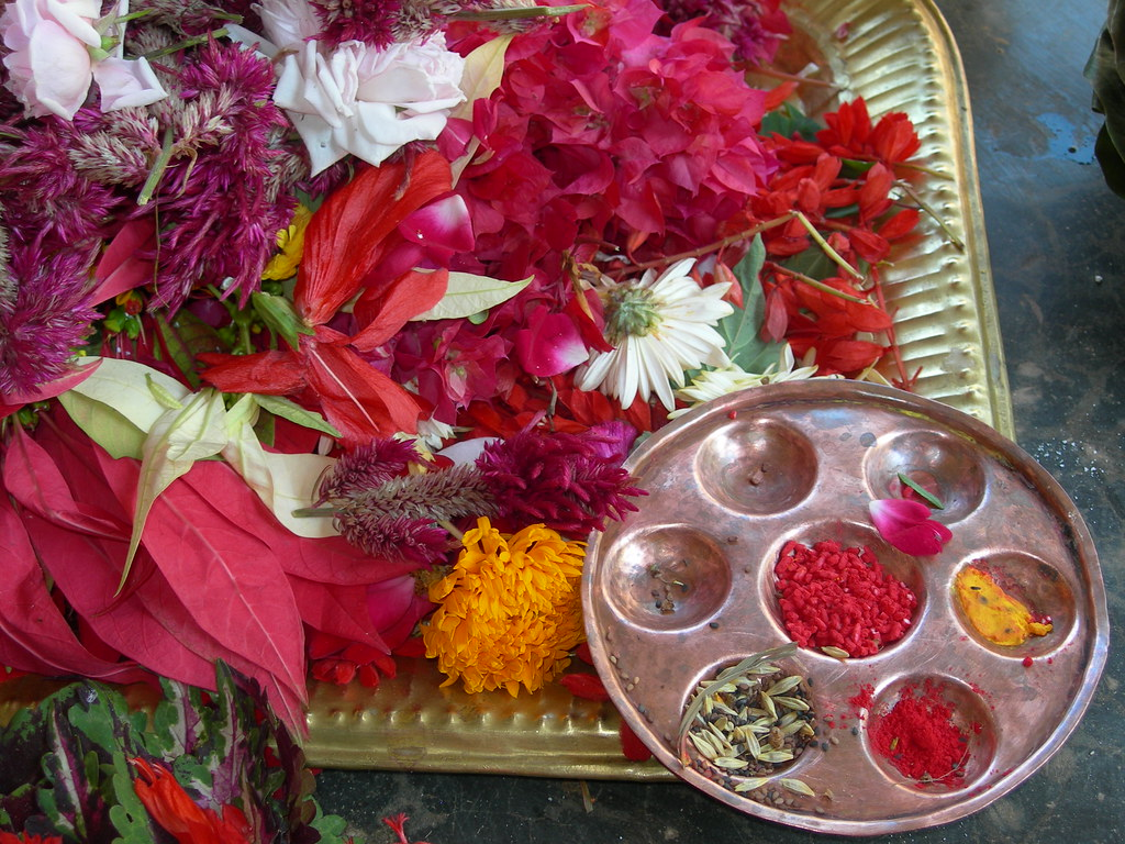 Puja tray flowers rice colored powder deana zabaldo for Navratri decorations at home
