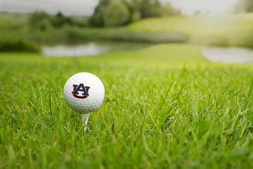 An Auburn golf ball is pictured on turf grass. (Flickr.com)