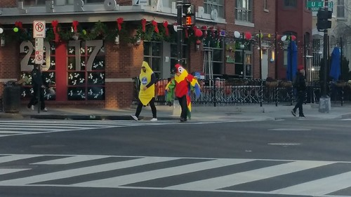 People costumed as Chiquita banana and a chicken on New Year's Day, 13th and U Streets NW