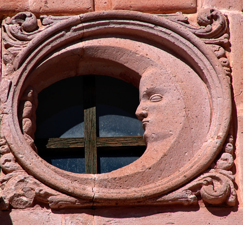 Window with a moon carved in the pink stone typical of Zacatecas, Mexico