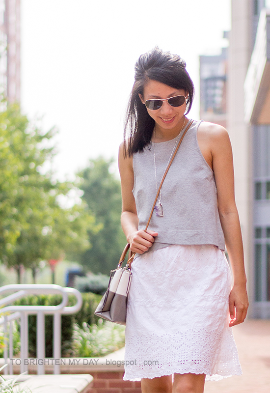 gray cropped vest, white eyelet dress, colorblocked crossbody bag