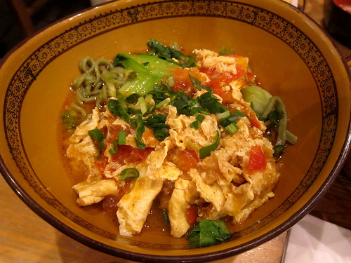 Spinach noodles in stir fried tomato sauce with eggs