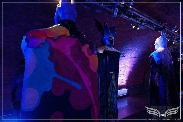 The Establishing Shot: BATMAN: ARKHAM KNIGHT CAPE & COWL EXHIBITION - L-R FR... BY CRASH, BATWOMAN BY KID ACNE & FADE TO BAT BY JODIE KIDD - KACHETTE, LONDON