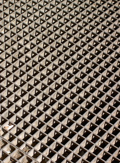 Grate and shadow outside Gard du Nord | by robpatrick
