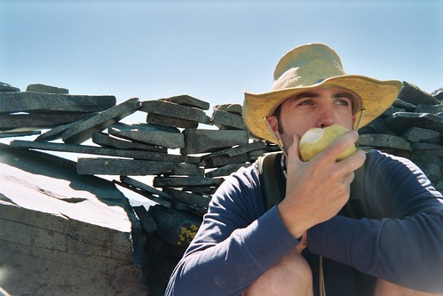 hat man and his apple | by SomeThingsIKnow
