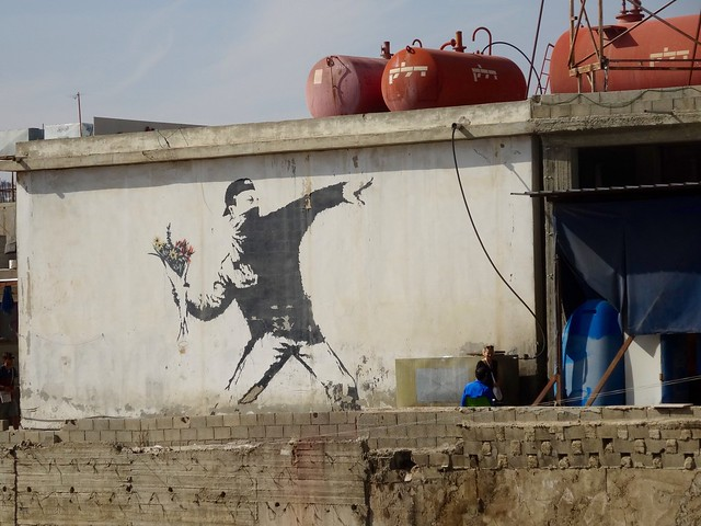 "Banksy art ""Man throwing flowers"""