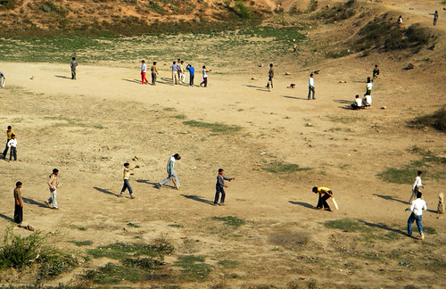 A cricket game seen from the train to Agra, India