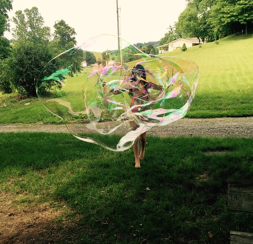Julia makes a giant bubble