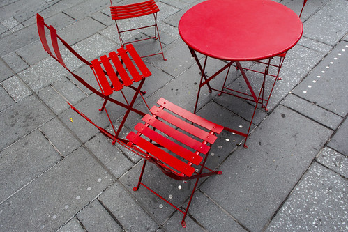 Red table and chairs on Times Square