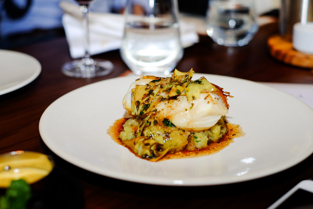 Bread Street Kitchen Dish: Roasted Black Cod with Crushed Potatoes, Salted Capers, Artichoke, Red Wine and Lemon Sauce