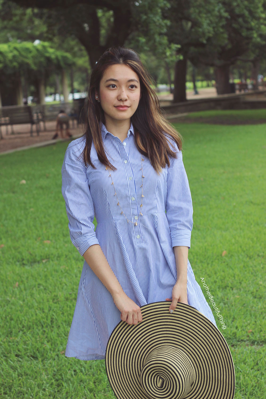 Striped sunhat and striped blue shirt dress