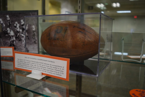 Picture of the 1957 national championship football in a glass case.