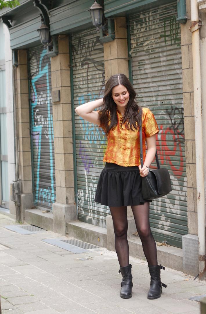 outfit: mustard silk cheongsam top, skater skirt, motor boots