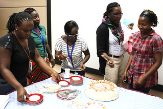 Africa Biosciences Challenge Fund fellows and BecA-ILRI Hub staff share out the cake to celebrate baby BecA