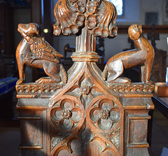 bench end: fox with a cockerel in its mouth and a howling wolf (15th Century)