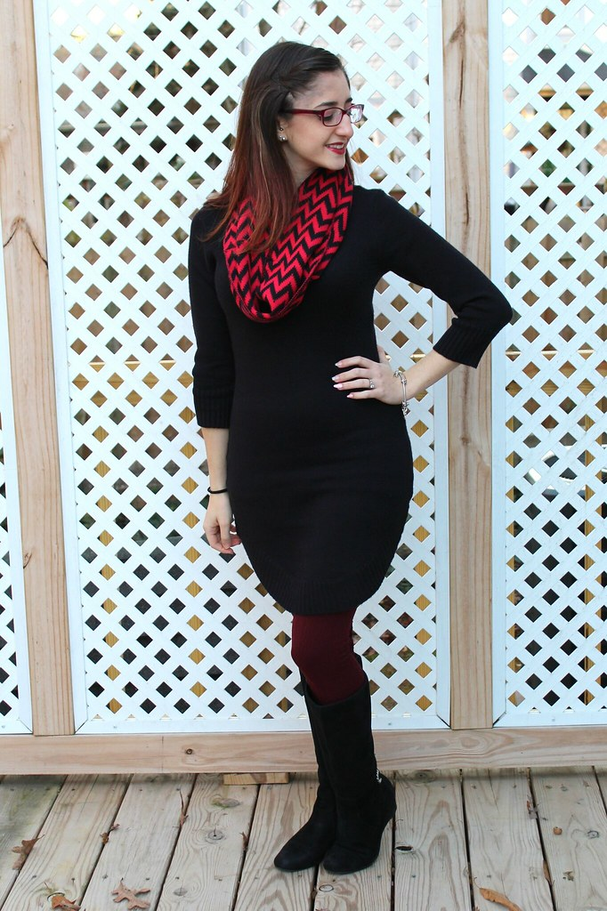 Black sweater dress with burgundy leggings and red and black chevron scarf
