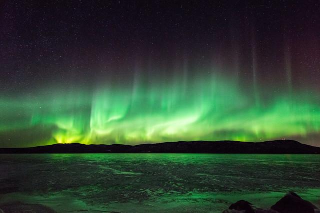 Green Swirls Over The Lake