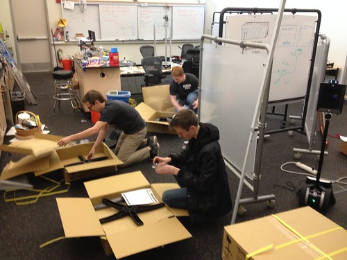 The Crew Gets to Work Assembling the Lab Stools