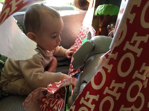 Ezra unwraps his first Christmas Present