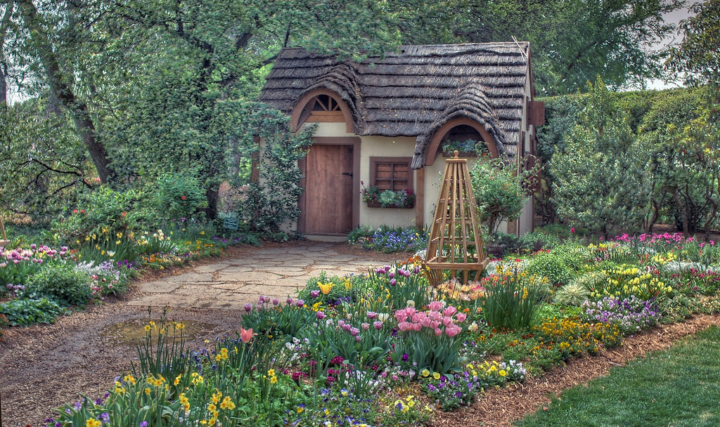 The magical cottage magical cottages in the woods still for Classic house with flower garden