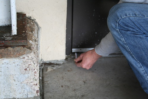 Checking door sweep for gaps | by The NYSIPM Image Gallery