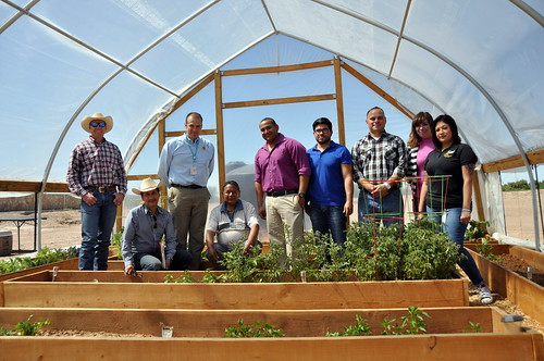 NRCS staff with Tribal Council members Javier Loera and Michael Silvas in a high tunnel